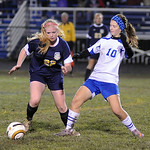 North Ridgeville's 22 Samantha Graham and Midview's Rachel Maver go after ball Oct. 18. Steve Manheim