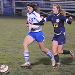 Midview's No. 23 Amanda Beursken and North Ridgeville's Julie Gunn chase after ball Oct. 18. Steve Manheim