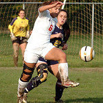 Elyria's #6 Haylie Davis tries to clear the ball away from North Ridgeville's #22 Morgan Wade.