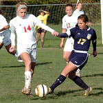 Elyria's #14 Erin Mariner and North Ridgeville's #17Catrina Engel fight for the ball.