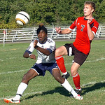 Oberlin's #11 Amani Crowley and Firelands' #7 Nathan Yorks fight to win the ball.