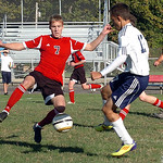 Firelands' #7 Nathan Yorks tries to move the ball past Oberlin's #17 Dante LaRiccia.