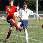 Firelands' #7 Nathan Yorks and Oberlin's #17 Dante LaRiccia fight for the ball.
