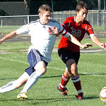 Oberlin's #4 Sam Weiss fights Firelands' #20 Gustave Tapper for the ball.