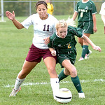 Wellington's #11 Elizabeth Bowman and Amherst's #2 Lindsay Sands fight for the ball.