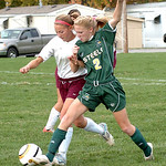 Wellington's #3 Megan Pitts and Amherst's #2 Brittany Evans fight for the ball.