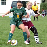 Amherst's #6 Jessica Sobotka and Wellington's #7 Brittany Mariast fight for the ball.