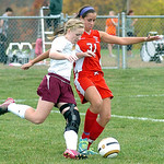 Wellington's #7 Brittany Mariast fights Cuyahoga Heights' #31 Sarah Baudo for the ball.