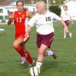 Wellington's #16 Julia Marks takes the ball down the field past Cuyahoga Heights' #13 Taylor McNeilly.