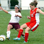 Wellington's #12 Shelby Cole takes the ball from Cuyahoga Heights' #10 Maddie Spicer.