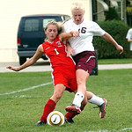 Wellington's #16 Julia Marks  takes the ball from Cuyahoga Heights' #1 Sierra McNeilly.