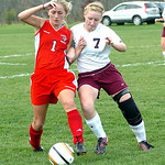 Wellington's #7 Brittany Mariast fights Cuyahoga Heights' #1 Sierra McNeilly for the ball.