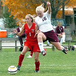 Wellington's #16 Julia Marks leaps for the ball past Cuyahoga Heights' #1 Sierra McNeilly.