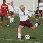 Wellington's Julia Marks takes a shot on goal.