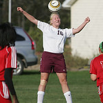 Wellington's Julia Marks on a header.