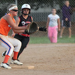 J. Head (#25) of M.C. Madness Black races the ball to second base as the Swarm's 2nd baseman R. Lovett is set for the catch in the ASA state softball semi-final game. photo by Ray Riedel