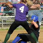 Kristen Teleha scores against Purple's Riley St. Marie. STEVE MANHEIM/CHRONICLE