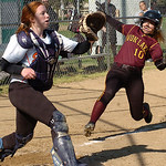 Avon Lake's #10 Paige Collins slides safely into home as North Olmsted's catcher #17 Molly Moennich waits for the ball.
