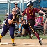 Avon Lake's #5 Ali Balthaser is out at first as North Ridgeville's #6 Toni Kiammer catches the ball.