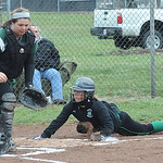 Columbia Emma Sullivan scores before ball reaches EC Marissa Bleich in first inning Apr. 14.  Steve Manheim