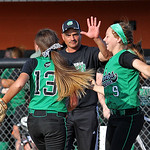 Head Coach Ken Lugo celebrates the Regional Semifinal 5-3 win over Loudonville with sophomore starting pitcher Kailey Minarchick (13) and junior third baseman Amanda Sedlock.