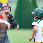 Carly Bachna, left, of Elyria, turns a double play beside Clay baserunner Bekah Yenrick yesterday in the second inning at Clyde High School. DAVID RICHARD / CHRONICLE