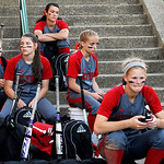 The Elyria varsity softball team waits for their bus to take them home after a loss to Grove City on Thursday. KRISTIN BAUER | CHRONICLE