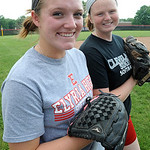 Caitlyn Minney, front, and Melanie Woodard of Elyria softball May 29.  Steve Manheim