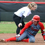 Elyria Caitlyn Minney slides safe into second on an RBI bunt in first inning Apr. 14.  North OLmsted 2B is Kayla Runyon.   Steve Manheim
