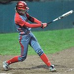 Elyria's Carly Bachna hits an RBI triple in the third inning against Mason. DAVID RICHARD / CHRONICLE