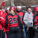 Elyria's Haley Looney is greeted by her teammates at home plate after hitting a home run in the bottom of the first inning Monday against Medina.