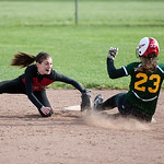 Elyria shortstop Marie Masters tags out Medina's Madison Tata at second base in the second inning Monday in Elyria.
