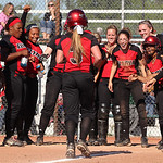 Elyria's Alyssa Barker (3) is greeted at home plate by teammates after hitting a solo homerun during the seventh inning against Medina. Photo by Aaron Josefczyk
