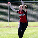 Elyria left fielder Patty Davis makes a catch off a hit by Medina's Lauren Peak during the seventh inning against Medina. Photo by Aaron Josefczyk
