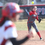Elyria High's #2 Marie Masters fires the ball to first to beat the runner and get the second out of the inning vs. Mentor.