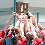 ANNA NORRIS/CHRONICLE<br /> The Elyria Lady Pioneers softball team lift their Division I regional championship trophy high in the air after their 4-0 win over Brecksville Saturday.