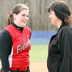 Firelands High School pitcher senior Samantha Dostall, left, talks with her head coach, and mother, Judy Dostall, following the Falcons loss to Keystone at South Amherst Middle School. Coach …