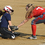Red All -Star 7 Patty Davis tags out Blue All- Star Jenna Yost at third base in second inn. June 11. Steve Manheim