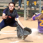 Avon's #2 Alexis Dill slides safely home as North Ridgeville's catcher #2 J. Yost waits for the ball.