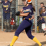North Ridgeville's #7 Kailey Demarco watches her ball drop over the fence for a home run.