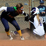 North Ridgeville's Marissa Caraballo tags out Pickerington Central's Alex Kiddwell at third base Saturday at the Akron Racers Showcase at Firestone Stadium in Akron. STEVE MANHEIM/CHRONI …