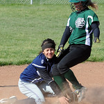 Elyria Catholic's Kenzie Roznac steals second base before the tag by Lorain's Marlayna Colon. STEVE MANHEIM/CHRONICLE