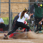 Elyria's Carly Bachn slides into home for the go-ahead run in the top of the sixth inning. CHRISTY LEGEZA/CHRONICLE
