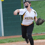 Medina's Caiti Rhodes makes a throw to first base. STEVE MANHEIM/CHRONICLE