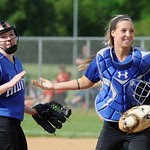 Midview pitcher Lauren Landers, left, is cheered on by catcher Cassie Haight. KRISTIN BAUER | CHRONICLE
