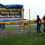 "Dorthy Chapman's family members unveil a sign that stands outside the fence in center field naming the field ""Dorthy Chapman Field."" AARON JOSEFCZYK/CHRONICLE"