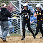 Black River's Kayla Gardner and Tori Smart head back to the dugout after scoring on a double by Sage Bourdess in the fifth inning against Firelands. AARON JOSEFCZYK / CHRONICLE