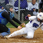 Keystone's Kodi Akers slides into home safely as Clearview catcher Elizabeth Janis misses the tag. STEVE MANHEIM/CHRONICLE
