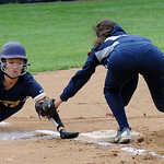 North Ridgeville's Sam Graham is tagged out at third base by Lorain's Gabby Amador. STEVE MANHEIM/CHRONICLE