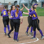 Avon players celebrate a good inning against Midview. KRISTIN BAUER | CHRONICLE
